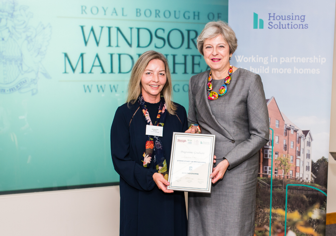 Striver Jacs receiving her certificate from Prime Minister Teresa May