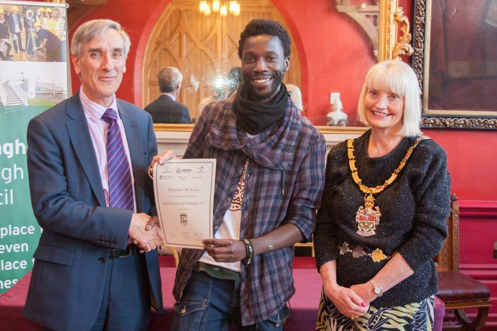 Matthew M'Kulia from Art Evolve receives his certificate from John Redwood MP