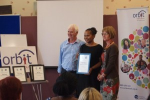 Fiona McDonald receiving her certificate from Paul and Vivien, one of the Dragons