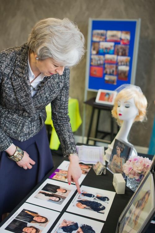 Theresa May viewing Oksana Williams Make Up portfolio